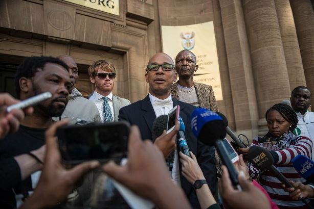 A miners attorney speaking to journalists outside the South Gauteng High Court in Johannesburg