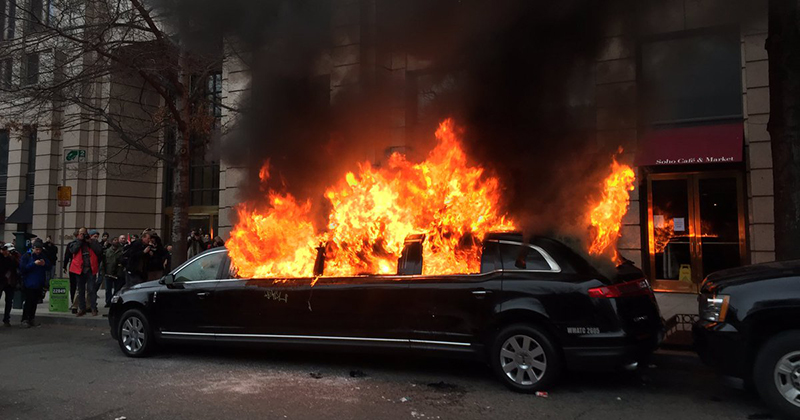 Civil unrest rioters burning limousine in Washington