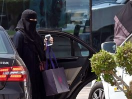 Saudi Arabia women getting out from her NBK-Mercedes car