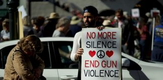 Man holding a sign 'End Gun Violence' at March for Our Lives protest in Santa Barbara, California