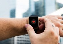 Man pressing buttons smartwatch heart monitor