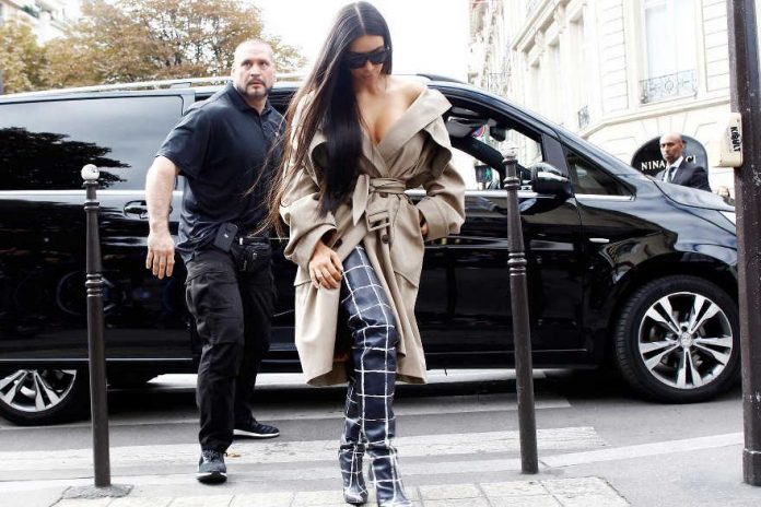 Kim Kardashian and her bodyguard Pascal Duvier seen out and about in Paris before the robbery on October 2, 2016 in Paris. Photo by Mehdi Taamallah/NurPhoto