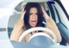 Unhappy woman driving her car